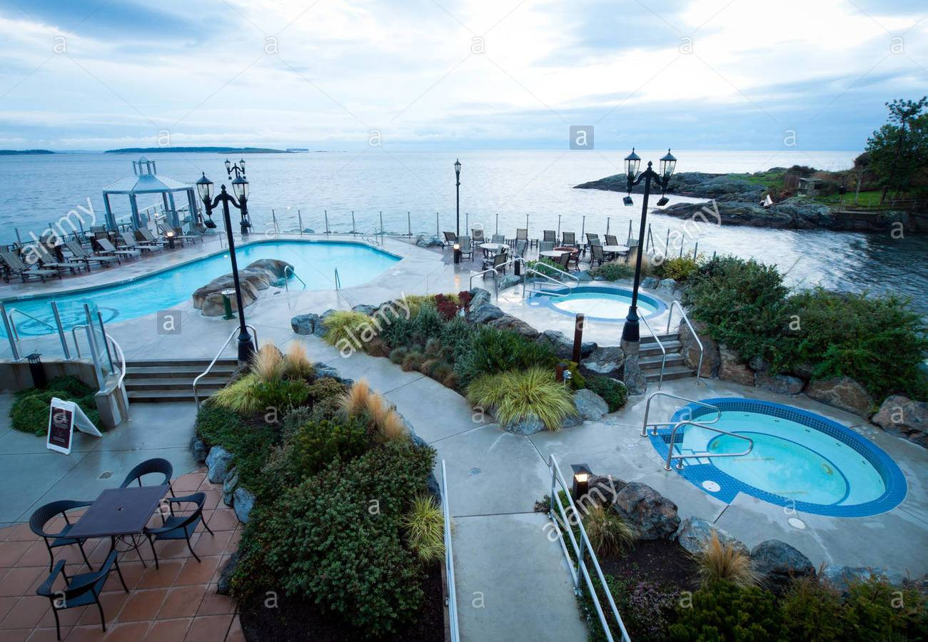 a-view-of-the-seaside-mineral-pools-of-the-oak-bay-beach-hotel-and-F6FG4B